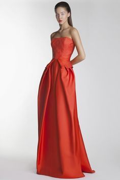 Tulip shape gown with lace overlay at bodice and peplum at waist