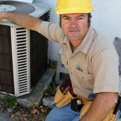 Photo about A handsome, competent looking air conditioning repairman. Image of gear, hvac, repairman - 314514 Air Conditioning Companies, Air Conditioning Installation, Air Conditioning Services, Heating And Air Conditioning, Ac Company, Commercial Hvac, Arctic Air, Ac System, Conditioner