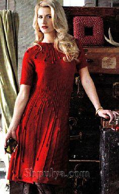 Размер: S,M,L Вязаное спицами платье с узором капельки дождя. Платье спицами с короткими рукавами и расклешенного силуэта. Платье связано из пряжи красного цвета.