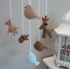 Custom made woodland animal nursery mobile.