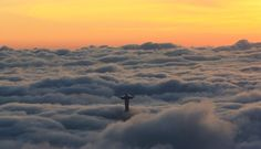 Dawn in Rio de Janeiro showing the Christ above the clouds.