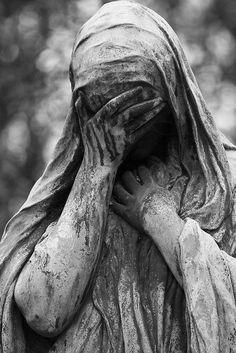 Cemeteries Ghosts Graveyards Spirits:  Weeping statue.