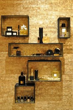 Shelves from CB2 were given a quick coat of paint and hung on the wall for pretty and practical storage.    From show house to your house: Textural walls are great for small and large spaces, since they add another layer of visual interest to a space. Look for something big and bold, like the gold wallpaper in this space, or something more subtle and refined for a larger bedroom or living room.