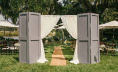 Use curtains and old closet doors, easier than using big doors for an outdoor wedding