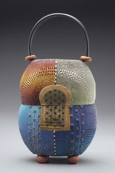 Amasya Purse made of colored polymer clay with intricately hand-applied texture in layers of pattern.