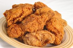Finger-Lickin' Fried Chicken Recipe with chicken wings, large eggs, milk, hot sauce, flour, sazon seasoning, adobo seasoning, seasoning salt, chili powder, pepper, garlic powder, vegetable oil