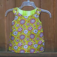 Reversible Zen Dress by Blooms and Bugs:   Make two dresses at once with the Reversible Zen Dress. If your child spills something on one side, just flip it inside out and you have a new, clean outfit ready to wear. Learning how to sew a dress is easier than you thought with this step-by-step tutorial.