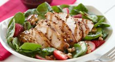 Spinach salad becomes a meal with the additional of grilled chicken. Strawberries, pecans and a honey balsamic dressing make it perfect for the summer.