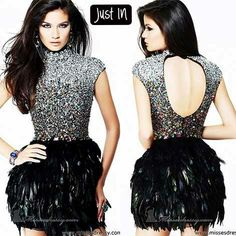 NEW ARRIVALS!!!!  Check out this stunning cap-sleeved feathered dress by @Sherri Hill: http://www.missesdressy.com/dresses/designers/sherri-hill/21045?track=35691911.r.23