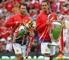 Giggs & Ferdinand with the Premier League & European Trophies at Old Trafford.