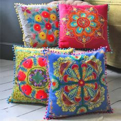Add instant colour to your room with these gorgeous vibrant cushions. These square embroidered gypsy caravan cushions with pom pom trim are inspired by Indian tribal patterns and prints. Each cushion features a zip closure on the back and a feather cushion pad.