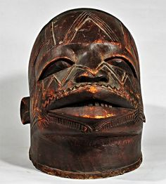 https://flic.kr/p/Q2M7VK | Tanzania/Mozambique, Makonde - Lipiko Helmet Mask | COUNTRY:  MOZAMBIQUE ETHNIC GROUP:  MAKONDE MATERIALS:  WOOD HEIGHT:  9 1/2 in.  Little is known of the culture of the Makonde people.  They believed in ancestral spirits and practiced initiation rites in which masks were used.    Most of the masks show a considerable degree of realism, sometimes with an element of caricature.  The face is that of a male with large, flat curving lips, open mouth with thin filed…