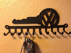 VW Key Holder...These also work great for lanyards, medals, ties, rings and jewelry!  CNC plasma cut steel. Powder coated wrinkle black. Will hold ten