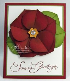 """punch out nine petal using ornament punch from red and three from green for the leaves.  Score them down the middle to fold in half.  Then sponge all the edges, with coordinating ink to give it some depth.  rub the back side of each petal with bone folder to give a little shape.  arrange the first five petals onto a 1 3/4"""" red circle, then add the remaining four petals with glue dots.  The leaves go on last behind the petals"""