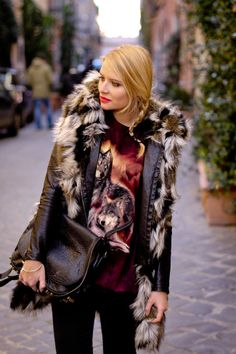Fox shirt paired with fox fur? Now that's how you do fashionable irony. #streetstyle