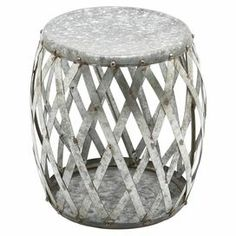 "Add a delightful pop of style to your home with this charming design.  Product: Stool     Construction Material: Galvanized metal  Color:  Rustic silver   Dimensions: 17"" H x 16"" Diameter"
