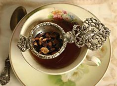 Here is a Victorian Silver tea strainer