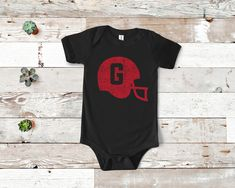 Excited to share this item from my shop: Baby Helmet One Piece Third Child Announcement, 3rd Pregnancy Announcement, Georgia Bulldogs Baby, Toddler Football, Baby Helmet, Sister Shirts, Pregnancy Shirts, Teacher Shirts, Mom And Dad