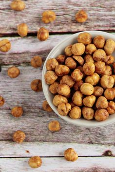 boil hazelnuts in baking soda and water (2 cups boiling water to 1 cup hazelnuts and 3 tablespoons baking soda) for a few minutes then immerse them in cold water before you peel the skins away