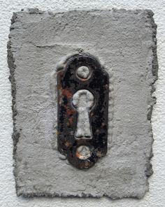Portal No. 4 Mantra Series, Found lock hardware, mortar, and fiberglass mesh  3 inches h x 2 inches w