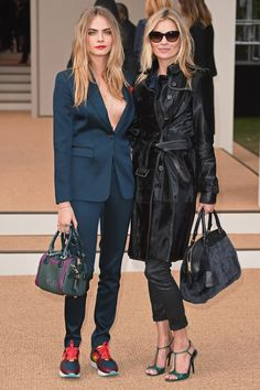 Cara Delevingne and Kate Moss at Burberry - London Fashion Week