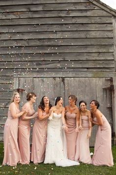 This shot of the bride and her bridesmaids is so fun! Confetti is a must!