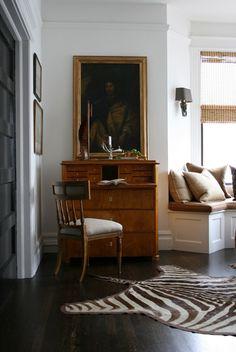 antique secretary and zebra rug vignette