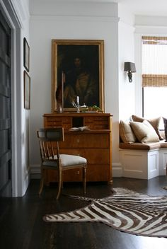 French Antiques and Zebra Skin Rug create a masculine and inviting room.