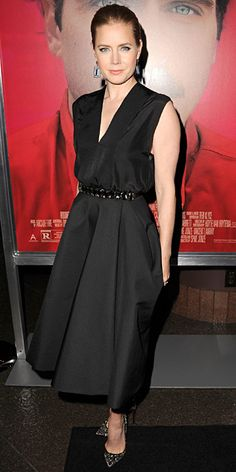 Amy Adams wearing a black Lanvin dress, with a sparkly belt, David Yurman jewelry, an embellished Valentino clutch, and bead-embroidered Christian Louboutin pumps.