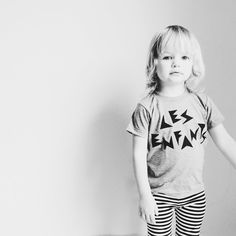 'Les enfants' means 'the kids' in French. Our 'Les Enfants' shirt is a representation of childhood in the form of a band t-shirt because every kid rocks!