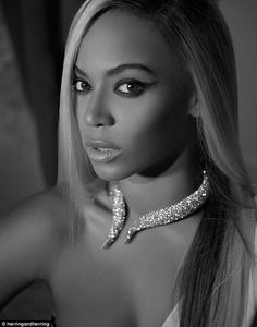 Diamonds are a girl's best friend: The September image of Beyonce shows her wearing just a sparkling choker contrasting with poker straight ...