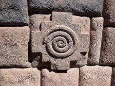 Chakana (Andean cross) with spiral, on classic Quechua architecture, at Pisac…