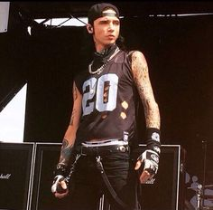 I was at Warped Tour with my best friend and she went to get something. Black Veil Brides comes on stage and everyone cheers loudly. After a few minutes someone comes up to me. A guy, about 5 inches taller than me asks me why I'm alone. He starts trying to talk to me and I try to move away every time. (Open rp for Andy)
