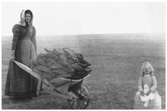 Pioneer families collecting Buffalo chips, also known as Meadow Muffins to use as fuel. Late 19th Century.
