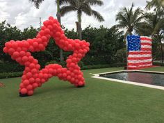 Red star balloon sculpture and American Flag balloon sculpture for Macy's magazine advertising for Father's Day http://www.dreamarkevents.com/ #flag #americanflag #balloonflag #star #redstar #starballoon #balloonstar #independentday #balloonredstar