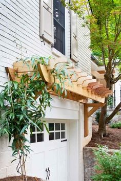 Simple pergola over garage door