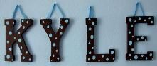 Image from http://www.camillelovedesigns.com/sitebuilder/images/brown_cut_out_letters_with_blue_polka_dots-221x94.jpg.