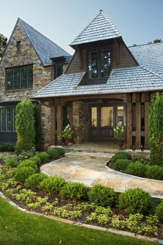 the house is stunning and the curved stone walkway and landscaping adds to the curb appeal