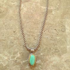 Beautiful Vintage Necklace Vintage necklace with a stunning Turquoise Stone siting on a silver and gold tone 316L  Stainless Steel base. Zomar Jewelry Necklaces