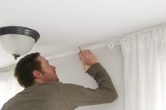How to Hang a Canopy from the Ceiling Without Drilling Holes | eHow