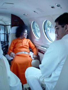 a rare pic of Swami in a plane.