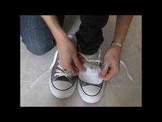 How to wear converse with skinny jeans! - she doesn't like the shoelace bow to show, so she does a simple tutorial on how to hide it and make the shoes comfortable with skinny jeans - her outfit is cute too