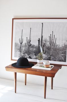 Oversize art can make a such a positive impact on a space! Love this black and white addition to this all white + vintage mid century modern room.