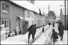 I love this image, especially the old man up in the window looking down onto the street.     Dolton after the Great Blizzard by James Ravilious © Beaford Arts, 1978