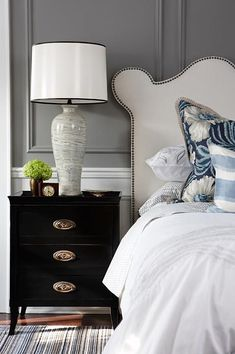 *grey....black....white bedroom. Like tge nailhead trim, lamp and table. Nice room all around.