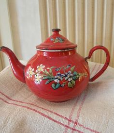 Lovely and rare French enameled tea pot from the early 900s, rare red color called rouge imperial and hand painted bounch of violets and