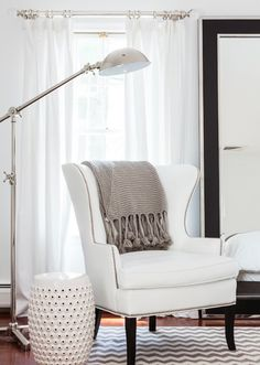 white wing chair, garden stool - put current wing chair in the back corner, by the window with a garden stool?