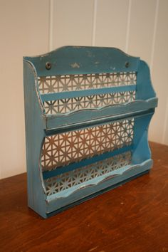 Refurbished vintage spice rack, Can be used for traditional use or for nail polish rack. Painting in a shabby chic turqouise with a weathered stain.