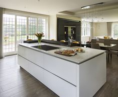When including an island in your open plan kitchen, maximise on space by integrating storage within the island, such as sleek drawers for pots and pans. Open Plan Kitchen, Living Area, Marble Wood, Black Marble, Kitchen Design, Design Inspiration, Flooring, How To Plan, Dining