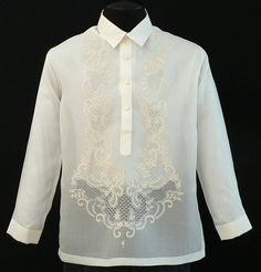 Jusi Barong Tagalog #1020 Whether you want to dress like a groom or a guest, this distinguished embroidery fits the bill for both. Its Jusi fabric compliments the warmer months of Summer so it sets off dress pants and dress shoes like a charm. #BarongsRUS #barong